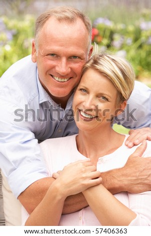 Couple Relaxing In Garden - stock photo