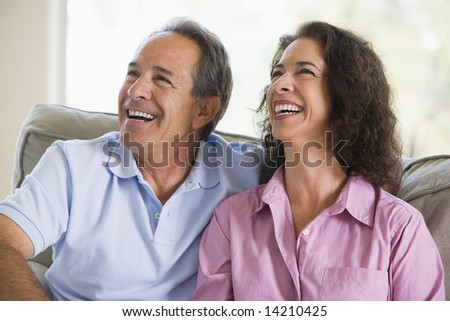Couple relaxing in living room and laughing