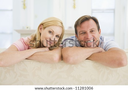 Couple relaxing in lounge - stock photo