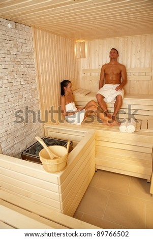 Couple relaxing in sauna on wellness trip, enjoying healthy program.? - stock photo