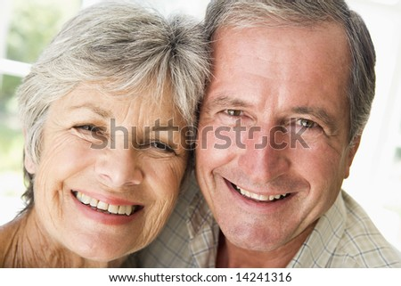 Couple relaxing indoors smiling