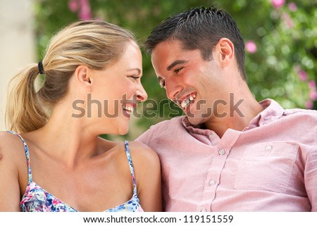 Couple Relaxing On Sofa At Home - stock photo
