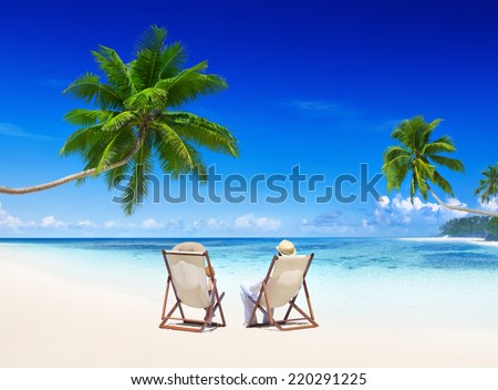 Couple relaxing on the beach. - stock photo