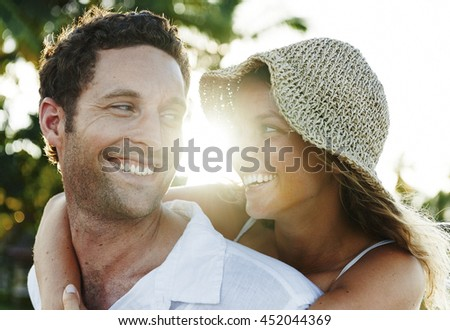 Couple Relaxing on the Beach Concept - stock photo