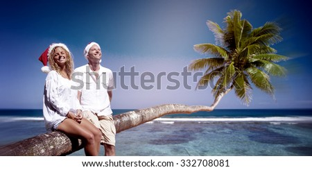Couple Relaxing on the Beach Honeymoon Concept - stock photo
