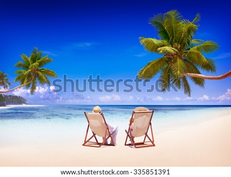 Couple Relaxing on the Beach Tourism Nature Concept - stock photo