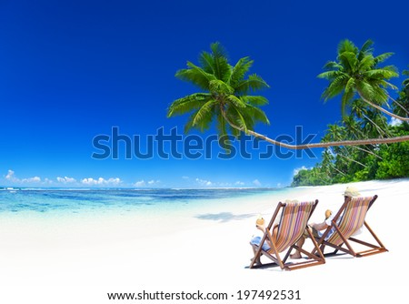 Couple relaxing on the tropical beach. - stock photo