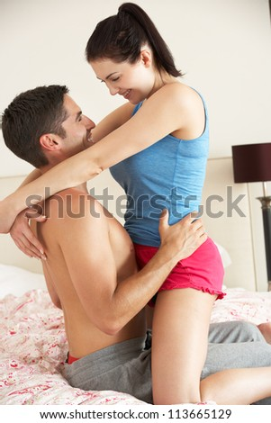 Couple Relaxing Together In Bed - stock photo