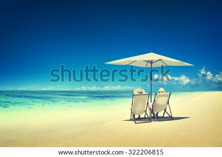 Couple Relaxing Tropical Beach Ocean Summer Travel Concept - stock photo