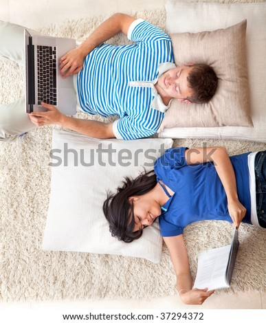 Couple relaxing with some leisure activities at home - stock photo
