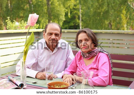 Couple retired lifestyle enjoy fresh air and balcony meal - stock photo
