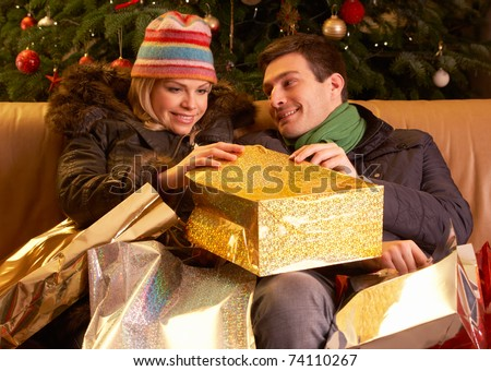 Couple Returning After Christmas Shopping Trip - stock photo