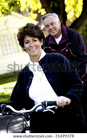 Couple riding bicycles - stock photo