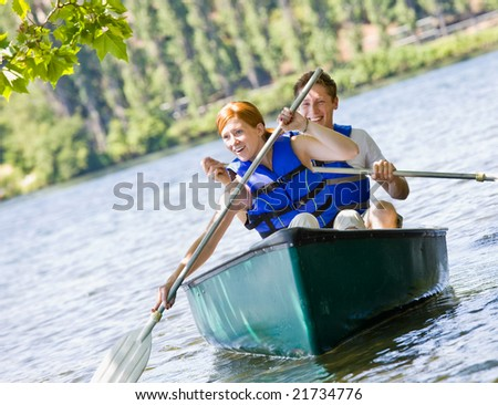 Couple rowing boat - stock photo
