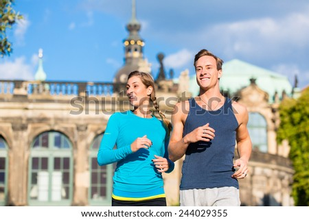 Couple running at Zwinger in Dresden