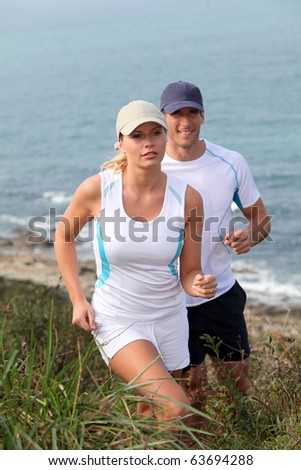 Couple running outside on a sunny day