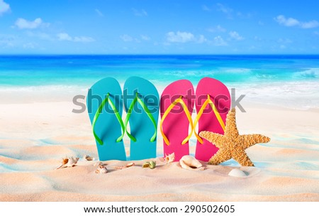 couple sandals and shells on sand - beach holiday in two - Summer  - stock photo