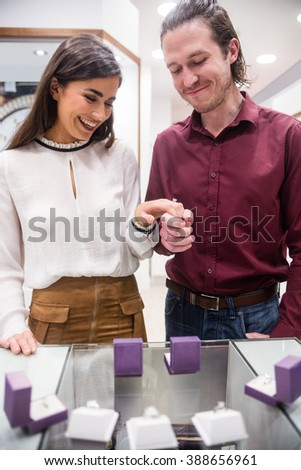 Couple selecting a finger ring in jewelry shop - stock photo