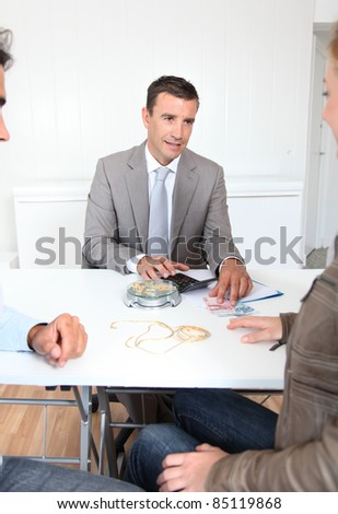 Couple selling gold for cash - stock photo
