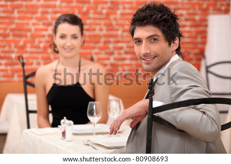 Couple sharing a romantic dinner together - stock photo