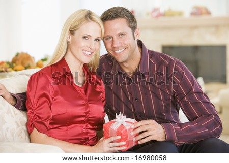 Couple Sharing Christmas Present - stock photo