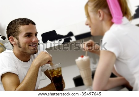 couple sharing soda