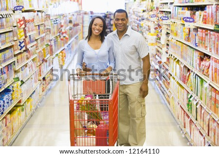 Couple shopping for groceries in supermarket - stock photo