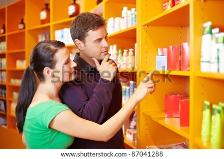 Couple shopping for medical products in a pharmacy - stock photo