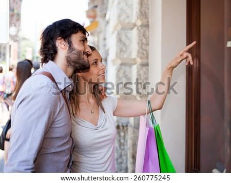 Couple shopping in an urban street - stock photo