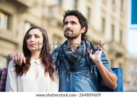 Couple shopping in an urban street - stock photo