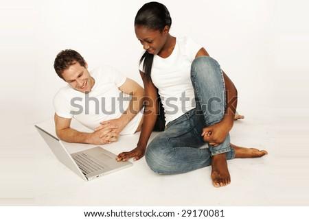 Couple shopping on internet paying on-line, - stock photo