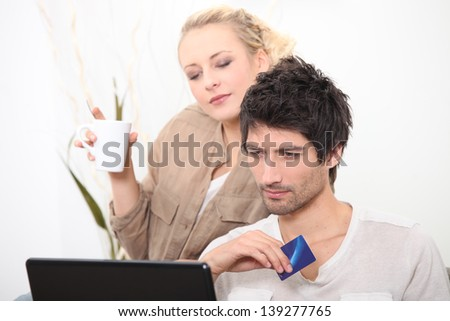 couple shopping online - stock photo