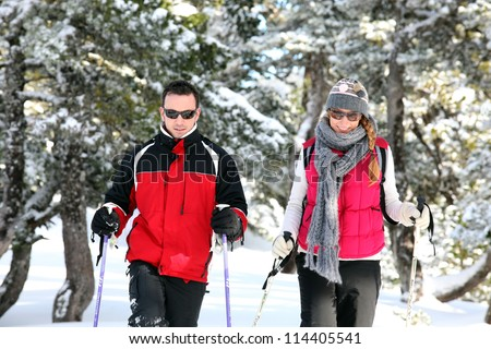 Couple show-shoeing - stock photo