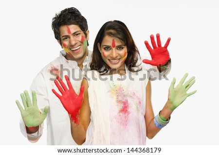 Couple showing their colored hands on Holi - stock photo