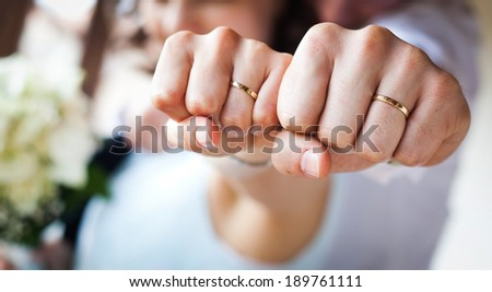 Couple showing their new wedding rings