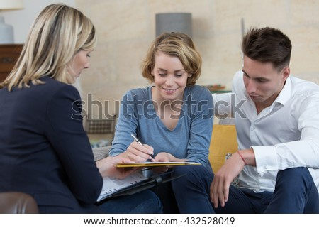 couple signing financial contract