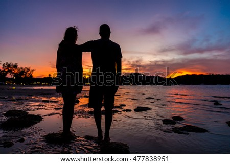 Couple silhouette in a sunset in Thailand