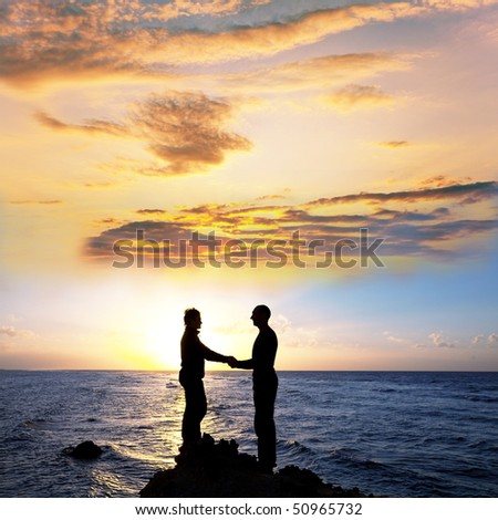couple silhouette on sunrise - stock photo