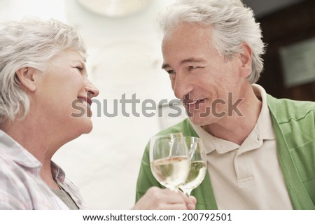 Couple sitting at table with wine glasses