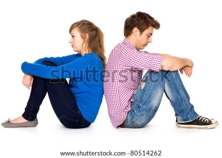Couple sitting back to back - stock photo