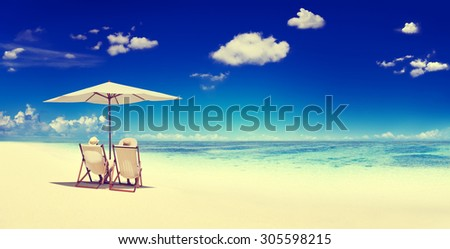 Couple Sitting Beach Summer Getaway Concept - stock photo