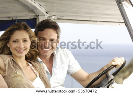 couple sitting in a car during a trip - stock photo