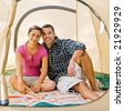 Couple sitting in tent - stock photo