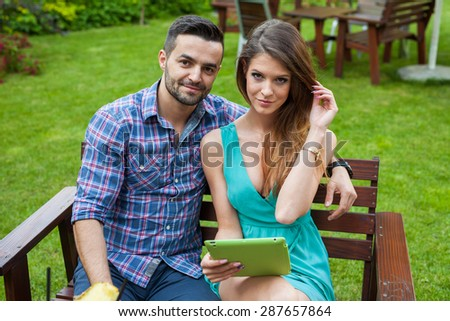 Couple Sitting Garden On Bench Using Stock Photo (Edit Now ...