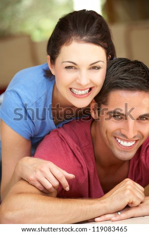 Couple Sitting Lying House - stock photo