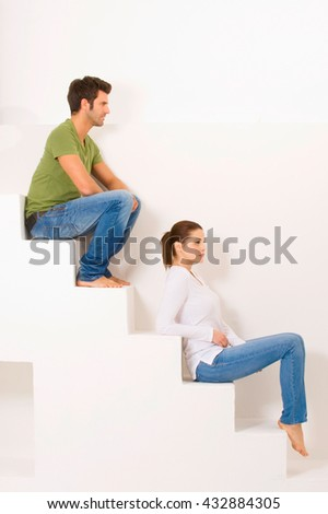 Couple sitting on the steps - stock photo