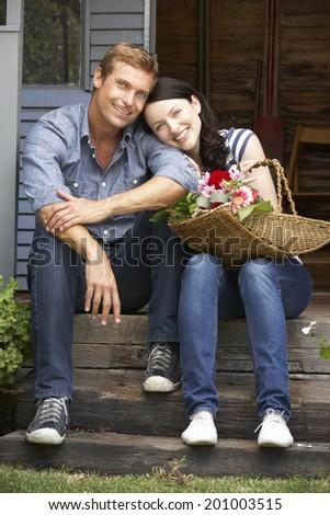 Couple sitting  on veranda - stock photo