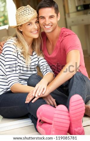 Couple Sitting Outside House - stock photo