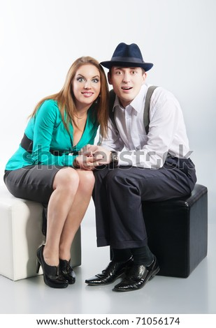 couple sitting together and watching a fascinating movie - stock photo