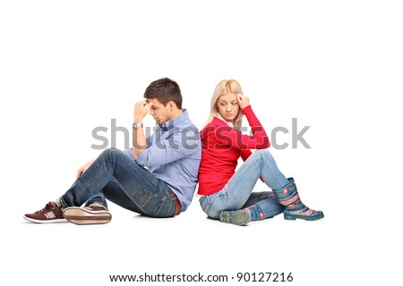 Couple sitting with their backs turned after having an argument isolated on white background - stock photo